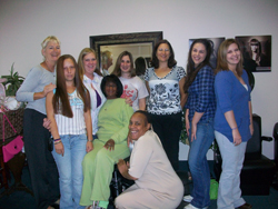 EOTC's Elaine Donly (far left) greets women in her transitions group.