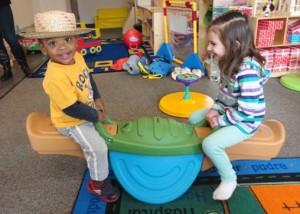 Micah & Bella learn turn-taking and teamwork during Toddler Playgroup.