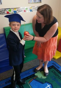 "Upon graduation from the Parents as Teachers program, Alfred presents his mom with an apple to ""thank"" her for being his FIRST teacher!"